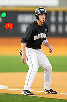 Steven Brooks #1 of the Wake Forest Demon Deacons takes his lead off of third base against the Miami Hurricanes at Gene Hooks Field on March 19, 2011 in Winston-Salem, North Carolina.  The Hurricanes defeated the Demon Deacons 4-3.  Photo by Brian Westerholt / Four Seam Images