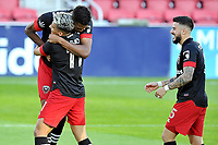 WASHINGTON, DC - NOVEMBER 8: Donovan Pines #23 of D.C. United celebrates his score with teammates Yamil Asad #11 of D.C. United and Junior Moreno #5 of D.C. United during a game between Montreal Impact and D.C. United at Audi Field on November 8, 2020 in Washington, DC.