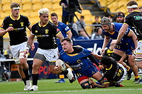 Dylan Nel of Otago is tackled by Kemara Huiti-Parapara of Wellington during the Mitre 10 Cup - Wellington v Otago at Sky Stadium, Wellington, New Zealand on Saturday 10 October 2020. <br /> Photo by Masanori Udagawa. <br /> www.photowellington.photoshelter.com