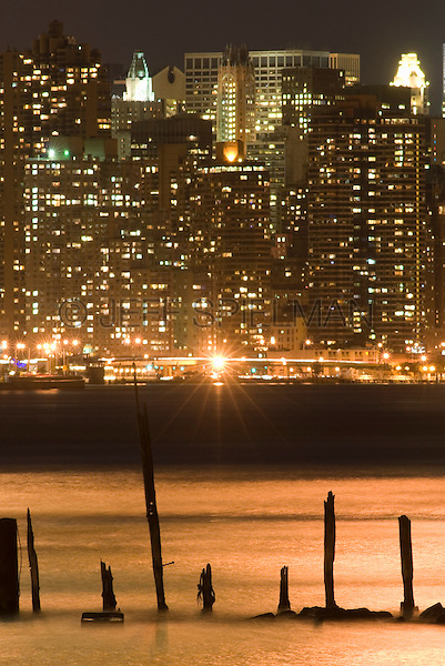 New York Cityscape - East River at Night, Midtown Manhattan in the Distance, New York  City, New York State, USA
