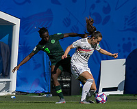 GRENOBLE, FRANCE - JUNE 22: Sara Daebritz #13 of the German National Team brings the ball forward as Chinwendu Ihezuo #19 of the Nigerian National Team defends during a game between Nigeria and Germany at Stade des Alpes on June 22, 2019 in Grenoble, France.
