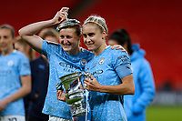 1st November 2020; Wembley Stadium, London, England; Womens FA Cup Final Football, Everton Womens versus Manchester City Womens; Steph Houghton of Manchester City Women poses with the Womens FA Cup Final Trophy alongside Janine Beckie of Manchester City Women with the Womens FA Cup Final Trophy lid on her head