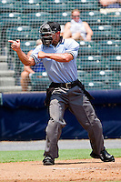Home plate umpire Joey Amaral makes a strike call during the Eastern League game between the Harrisburg Senators and the Richmond Flying Squirrels at The Diamond on July 22, 2011 in Richmond, Virginia.  The Squirrels defeated the Senators 5-1.   (Brian Westerholt / Four Seam Images)