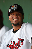Tri-City ValleyCats catcher Alfredo Gonzalez (7) in the dugout during a game against the Batavia Muckdogs on August 2, 2014 at Joseph L. Bruno Stadium in Troy, New  York.  Tri-City defeated Batavia 8-4.  (Mike Janes/Four Seam Images)