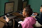 Elementary school Grade 2 students using computers