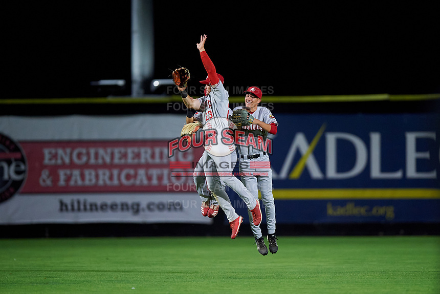 Vancouver Canadians Dominic Abbadessa (2), Cameron Eden (27), and Will Robertson (23) celebrate a victory after a Northwest League game against the Tri-City Dust Devils at Gesa Stadium on August 21, 2019 in Pasco, Washington. Vancouver defeated Tri-City 1-0. (Zachary Lucy/Four Seam Images)