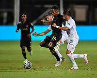 LAKE BUENA VISTA, FL - JULY 18: Mark-Anthony Kaye #14 of LAFC is pressured by Joe Corona #15 of LA Galaxy during a game between Los Angeles Galaxy and Los Angeles FC at ESPN Wide World of Sports on July 18, 2020 in Lake Buena Vista, Florida.