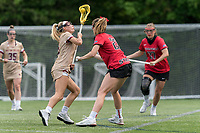 NEWTON, MA - MAY 14: Belle Smith #5 of Boston College powers through defense of Lindsey Barnes #23 of Fairfield University during NCAA Division I Women's Lacrosse Tournament first round game between Fairfield University and Boston College at Newton Campus Lacrosse Field on May 14, 2021 in Newton, Massachusetts.