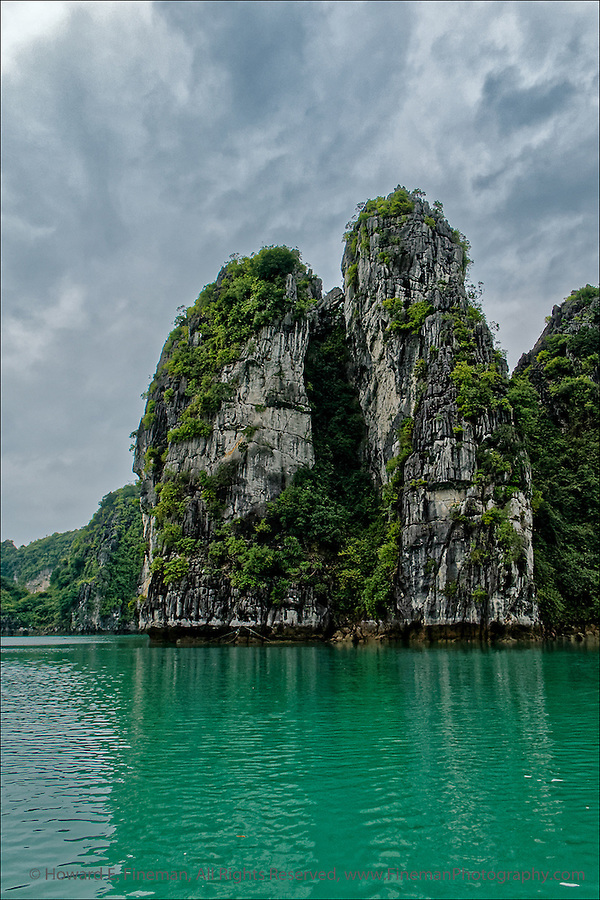 Sea Stacks in the Making, Ha Long Bay, Vietnam. This shows the famous emerald water of Ha Long Bay.