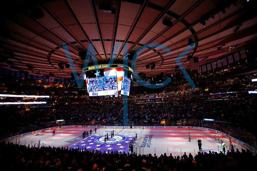 Members of the New York Rangers and the Pittsburgh Penguins line up during the national anthem during game four of the first round of the Stanley Cup Playoffs at Madison Square Garden in New York City on April 21, 2016. (Photo by Jared Wickerham / DKPS)