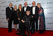 Linda Ronstadt arrives with, left to right, agent Shelly Schultz, and his wife, Susan, Jill Boylan and her husband, producer John Boylan,  producer Peter Asher, and Assistant  Janet Stark, arrive for the formal Artist's Dinner honoring the recipients of the 42nd Annual Kennedy Center Honors at the United States Department of State in Washington, D.C. on Saturday, December 7, 2019. The 2019 honorees are: Earth, Wind & Fire, Sally Field, Linda Ronstadt, Sesame Street, and Michael Tilson Thomas.<br /> Credit: Ron Sachs / Pool via CNP