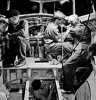 A skilled team of men and women workers at the Boeing plant in Seattle complete assembly and fitting operations on the interior of a fuselage section for a new B-17F (Flying Fortress) bomber, 1942.<br /> <br /> Photo by Andreas Feininger.