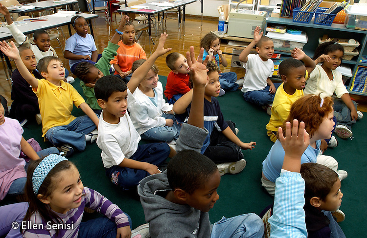 MR / Schenectady, NY .Yates Arts in Education Magnet School, Grade 2.Arts-Themed Urban Elementary School.Students raise hands to answer teacher's questions..MR: AE-g2c.© Ellen B. Senisi