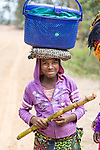 Girl Carrying Goods On Her Head