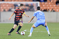 Houston, TX - Friday December 9, 2016: Drew Skundrich (12) of the Stanford Cardinal brings the ball up the with Mauricio Pineda (2) of the North Carolina Tar Heels defending at the NCAA Men's Soccer Semifinals at BBVA Compass Stadium in Houston Texas.