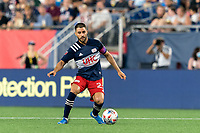 FOXBOROUGH, MA - JULY 7: Carles Gil #22 of New England Revolution dribbles at midfield during a game between Toronto FC and New England Revolution at Gillette Stadium on July 7, 2021 in Foxborough, Massachusetts.