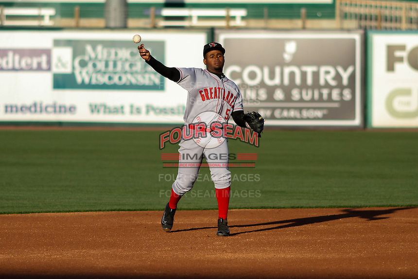 Great Lakes Loons infielder Christian Gomez (5) throws to third during a Midwest League game against the Wisconsin Timber Rattlers on April 26th, 2016 at Fox Cities Stadium in Appleton, Wisconsin.  Wisconsin defeated Great Lakes 4-3. (Brad Krause/Four Seam Images)