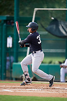 GCL Yankees West left fielder Stanley Rosario (38) follows through on a swing during the first game of a doubleheader against the GCL Braves on July 30, 2018 at Champion Stadium in Kissimmee, Florida.  GCL Yankees West defeated GCL Braves 7-5.  (Mike Janes/Four Seam Images)