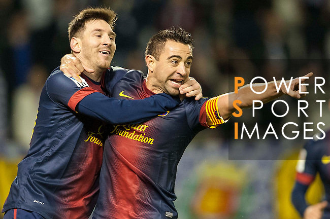 VALLADOLID, SPAIN - DECEMBER 22:  Xavi Hernandez of FC Barcelona celebrates with his teammate Lionel Messi after scoring against Real Valladolid at Jose Zorrilla on December 22, 2012 in Valladolid, Spain.  Photo by Victor Fraile / The Power of Sport Images