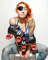 Pussy Venom, of the roller derby team, the Boston Derby Dames. Roller derby is an American contact sport, popular with young women, which combines both athleticism and a satirical punk third-wave feminism aesthetic.