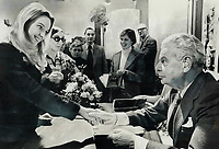 Donna Bentley, 22, gets a handshake from former prime minister John Diefenbaker in Toronto today. The Chief was at the downtown Simpson's store autographing copies of his two-volume memoirs, One Canada. About 400 people waited up to 30 minutes in line to meet Diefenbaker. Apart from autographs and handshakes they got vintage Dief comments - mixture of serious politics and political humor.