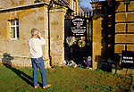 A VISITOR PHOTOGRAPHS A GATE TO ALTHORPE HOUSE (WHERE PRINCESS DIANA IS BURIED) WHERE OTHERS HAVE LEFT FLORAL TRIBUTES TO DIANA PRINCESS OF WALES,, 1998