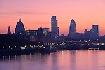 """United Kingdom, England, London: Sunrise over the City of London and River Thames from Waterloo Bridge, showing silhouettes of Saint Paul`s Cathedral and the `Gherkin` (also known as Swiss Re Building) 