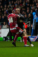 Friday 03 January 2014<br /> Pictured:Tom Issacs clashes with Kristian Phillips  of the Scarlets <br /> Re: Ospreys v Scarlets, Rabo Direct Pro 12 match at the Liberty Stadium Swansea, Wales