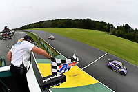 #23 Fast MD Racing Audi RS3 LMS TCR DSG, TCR: Nick Galante, James Vance, Nick Galante crosses the finish line under the checkered flag