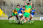 Tony Brosnan, Kerry in action against Brendan McCole, and Jason McGee, Donegal  during the Allianz Football League Division 1 Round 7 match between Kerry and Donegal at Austin Stack Park in Tralee on Saturday.