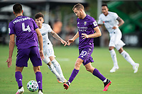 LAKE BUENA VISTA, FL - JULY 31: Oriol Rosell #20 of Orlando City SC kicks the ball during a game between Orlando City SC and Los Angeles FC at ESPN Wide World of Sports on July 31, 2020 in Lake Buena Vista, Florida.