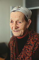 Bosnia and Herzegowina. Republika Serpska. Srebrenica. Djuka Micic is 86 years old. She is serb. She was a partisan during the World War II. She has lived her entire life in Srebrenica and never left the town during the bosnian war. She leaves alone and spends time in her kitchen, the only warm room in her flat during the winter season.© 2005 Didier Ruef
