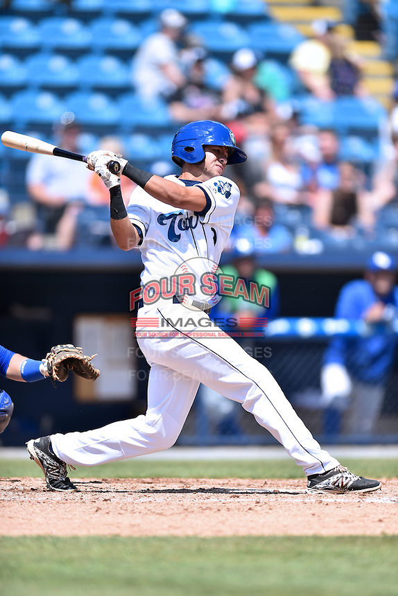 Asheville Tourists center fielder Omar Carrizales (19) swings at a pitch during a game against the Lexington Legends on May 3, 2015 in Asheville, North Carolina. The Legends defeated the Tourists 6-3. (Tony Farlow/Four Seam Images)