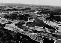 This air view presents a panorama of the 1;500;000 h.p. Shipshaw power project; one of the biggest hydro-electric developments in the world. In the middle of the picture is a one-and-a-half-mile canal dug mostly through solid rock. The cement poured would make a sidewalk 2;270 miles in length.<br /> <br /> <br /> [unknown]<br /> Picture, 1945<br /> <br /> PHOTO : Toronto Star Archives - AQP