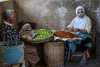 Yogyakarta, Java, Indonesia.  Women Selling Peppers, Beringharjo Market.