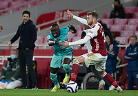 April 3rd 2021; Emriates Stadium, London, England;  Liverpools Sadio Mane gets past Arsenals Calum Chambers during the Premier League match between Arsenal and Liverpool at the Emirates Stadium in London