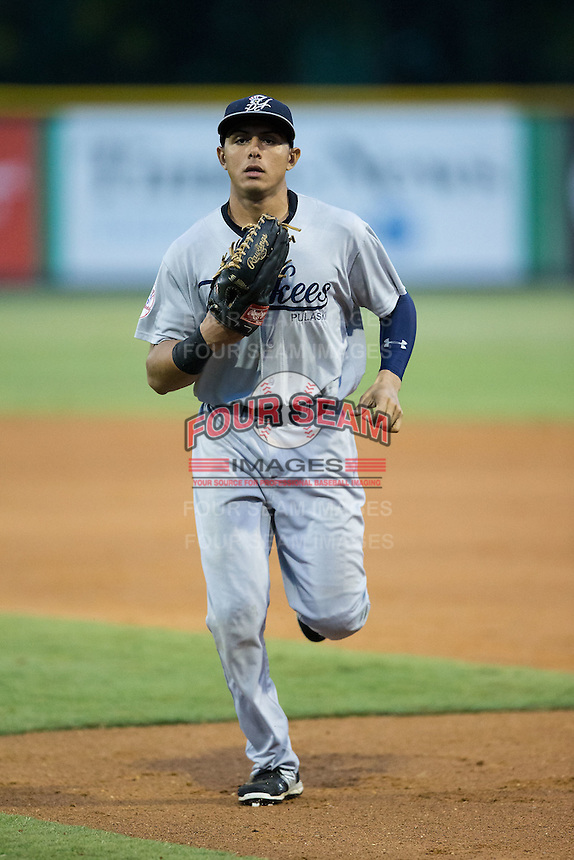 Pulaski Yankees center fielder Carlos Vidal (72) jogs off the field between innings of the game against the Burlington Royals at Burlington Athletic Park on August 6, 2015 in Burlington, North Carolina.  The Royals defeated the Yankees 1-0. (Brian Westerholt/Four Seam Images)