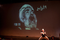 """Egitto Cairo """"Lessons in revolting"""" at Rawabet Theatre  August 2011`Lessons in Revolting is a performance created by a group of Egyptian activist-artists who want to rewrite their recent history through images, testimonials, scenes and sounds. The performance is directed by Laila Hassan Soleiman and Ruud Gielens with choreography by Karima Mansour."""