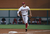 Arkansas infielder Brady Slavens (17) forces an out, Monday, June 7, 2021 in the fifth inning of the NCAA Fayetteville Regional at Baum-Walker Stadium in Fayetteville. Check out nwaonline.com/210608Daily/ for today's photo gallery. <br /> (NWA Democrat-Gazette/Charlie Kaijo)