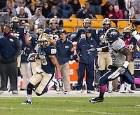 Pitt's Kevin Weatherspoon (88) makes a 56-yard punt return. The Pitt Panthers defeated the Old Dominion Monarchs 35-24 at Heinz Field, Pittsburgh, Pennsylvania on October 19, 2013.
