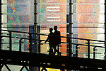 © Joel Goodman - 07973 332324 . 02/10/2016 . Birmingham , UK . Delegates cross an elevated walkway in the ICC as sun sets behind , at the close of the first day of the Conservative Party Conference at the International Convention Centre in Birmingham . Photo credit : Joel Goodman