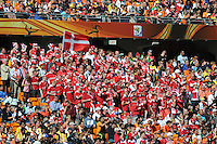 A unified group of Danish supporters cheer their team on against the Netherlands. Holland defeated Denmark, 2-0, June 14th, at Soccer City in the opening match of Group E of the 2010 FIFA World Cup.