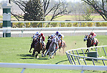 Karelian with Julien Leparoux (red cap) takes the lead at the top of the stretch and holds off Court Vision with Robby Albarado to win The Maker's Mark Mile at Keeneland Race Course. 04.09.2010