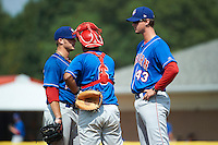 Auburn Doubledays pitching coach Sam Narron #43 talks with pitcher Nicholas Lee #29 and catcher Andruth Ramirez #6 during a NY-Penn League game against the Batavia Muckdogs at Dwyer Stadium on September 3, 2012 in Batavia, New York.  Auburn defeated Batavia 5-3.  (Mike Janes/Four Seam Images)
