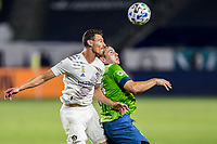 CARSON, CA - SEPTEMBER 27: Daniel Steres #5 of the Los Angeles Galaxy and Jordan Morris #13 of the Seattle Sounders battle for a ball in the air during a game between Seattle Sounders FC and Los Angeles Galaxy at Dignity Heath Sports Park on September 27, 2020 in Carson, California.