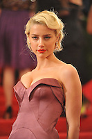 Amber Heard at the 'Schiaparelli And Prada: Impossible Conversations' Costume Institute Gala at the Metropolitan Museum of Art on May 7, 2012 in New York City. ©mpi03/MediaPunch Inc.