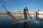 Sawing new ice in Yellowknife Bay