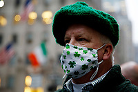 NEW YORK, NEW YORK - MARCH 17: A man attends St. Patrick's Day parade on March 17, 2021 in New York. St. Patrick's Day Parade organizers say they postpone the celebration, but a small group marched to preserve the tradition. (Photo by John Smith/VIEWpress)