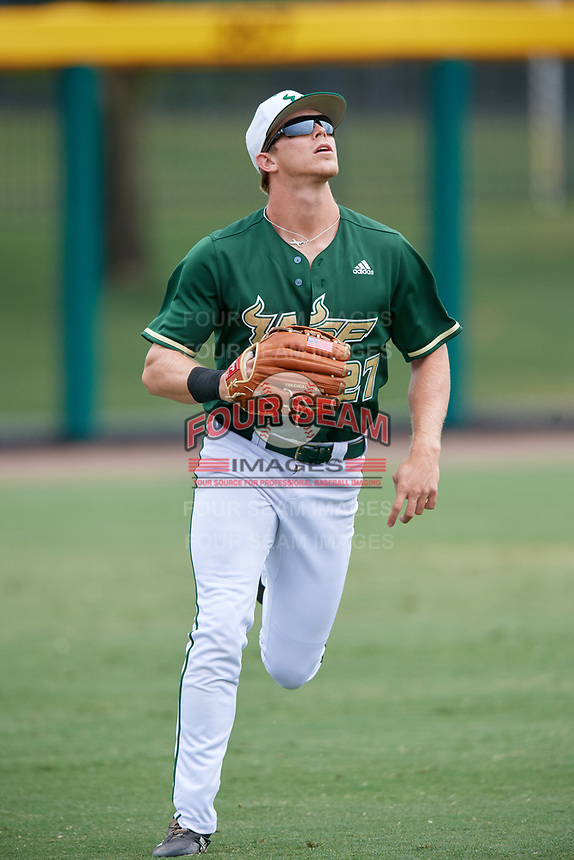 USF Bulls left fielder Garrett Zech (27) tracks a fly ball during a game against the Dartmouth Big Green on March 17, 2019 at USF Baseball Stadium in Tampa, Florida.  USF defeated Dartmouth 4-1.  (Mike Janes/Four Seam Images)