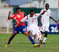 Alonzo Goot (16) of Panama fights for the ball with Reimond Salas (12) of Costa Rica during the quarterfinals of the CONCACAF Men's Under 17 Championship at Catherine Hall Stadium in Montego Bay, Jamaica. Panama defeated Costa Rica, 1-0.